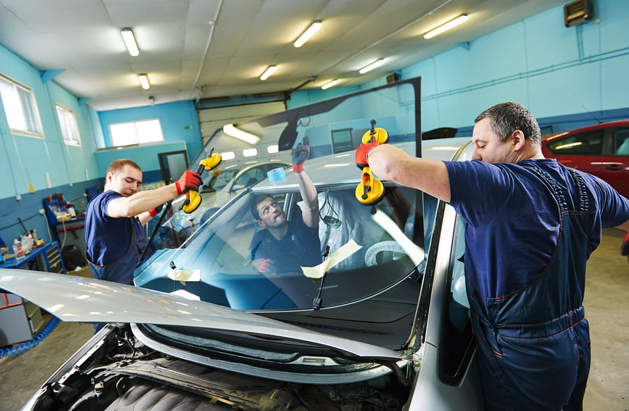 Lifting the auto glass replacement into position